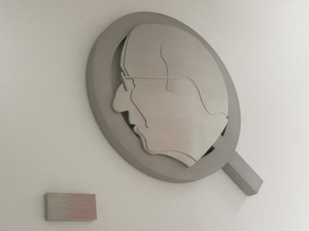 Depicting of the letter Q, commissioned by Quooker. Displayed is a side profile of Henri Peteri(1918-2007), inventor of the boiling water tap and the founding father of Quooker. Made in honour of the 25th anniversary of the company. Designed and manufactured by Marcel Timmers.