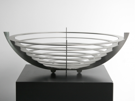 Brushed stainless steel bowl, in the shape of an ufo. 