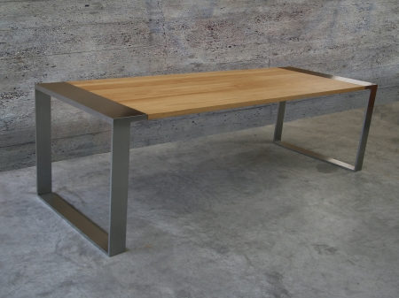 Oak table with stainless steel undercarriage and legs. Measurements 210 x 90 x 75 cm. Series of 1, of which 0 sold.