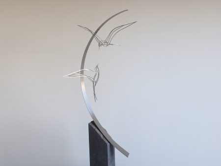 Stainless steel ring (Ø 128 cm.) with two tern birds interacting with each other. Placed on bluestone pedestal.